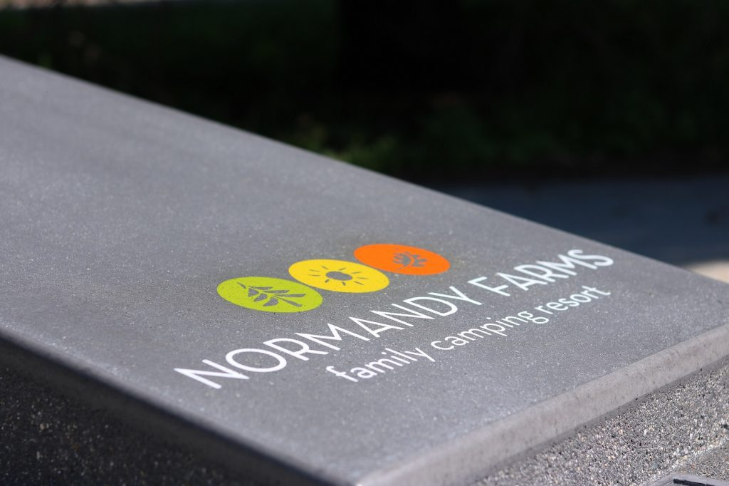 Camground concrete cornhole game with custom logo