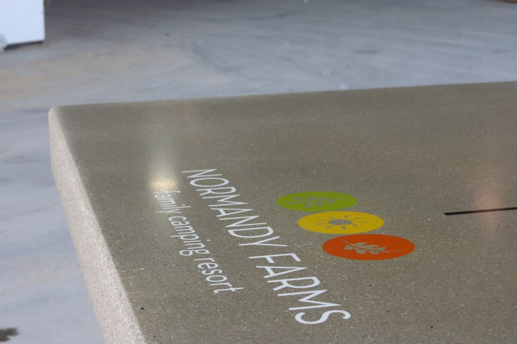 Ping Pong table top completely sealed and displaying logo on table tops.